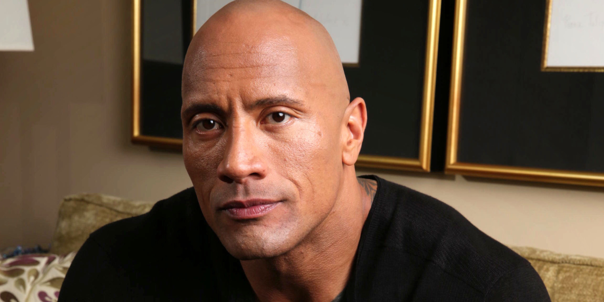 Dwayne Johnson poses for a portrait at the Four Seasons on Saturday, March 23, 2013 in Los Angeles. (Photo by Eric Charbonneau/Invision/AP)