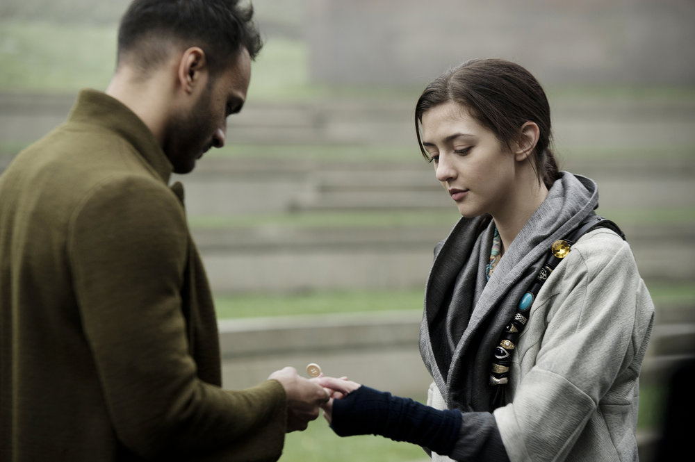 "THE MAGICIANS -- ""Homecoming"" Episode 110 -- Pictured: (l-r) Arjun Gupta as Penny, Katie Findlay as Eve -- (Photo by: Carole Segal/Syfy)"