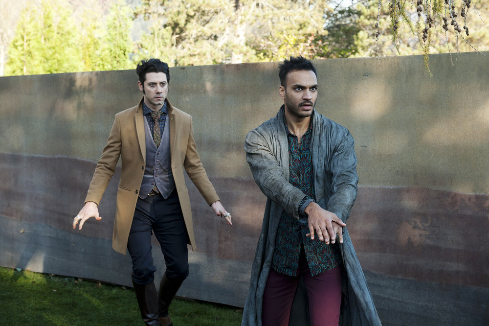 "THE MAGICIANS -- ""Thirty-Nine Graves"""" Episode 112 -- Pictured: (l-r) Hale Appleman as Eliot, Arjun Gupta as Penny -- (Photo by: Carole Segal/Syfy)"