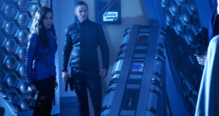 "KILLJOYS -- ""Schooled"" Episode 204 -- Pictured: (l-r) Hannah John-Kamen as Dutch, Aaron Ashmore as John -- (Photo by: Steve Wilkie/Syfy/Killjoys II Productions Limited)"
