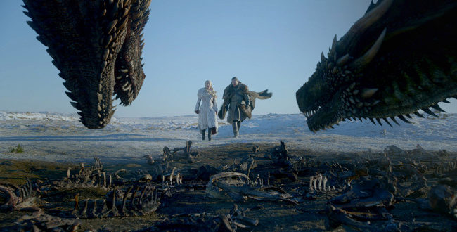 Two Dragons in the foreground, look at Daenerys and Jon Snow.