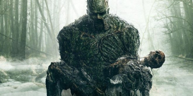 Swamp Thing Rises from the Deeps holding a corpse of his old body.