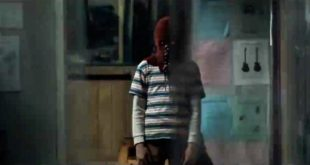 Brandon Breyer in costume. A red hood over his face which extends into a red cape.