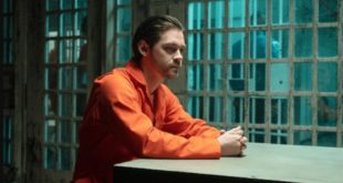 Tom Payne as Malcolm Bright in orange