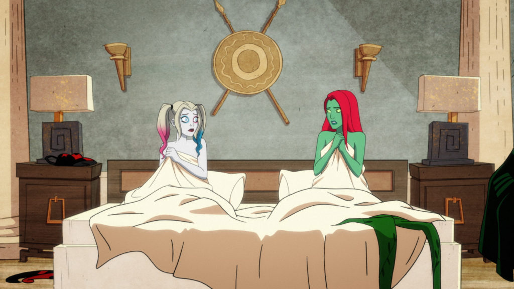 Harley Quinn and Poison Ivy in bed together after realizing they spent the night together, romantically.
