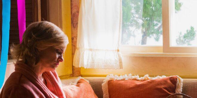 Betty Broderick sits alone.