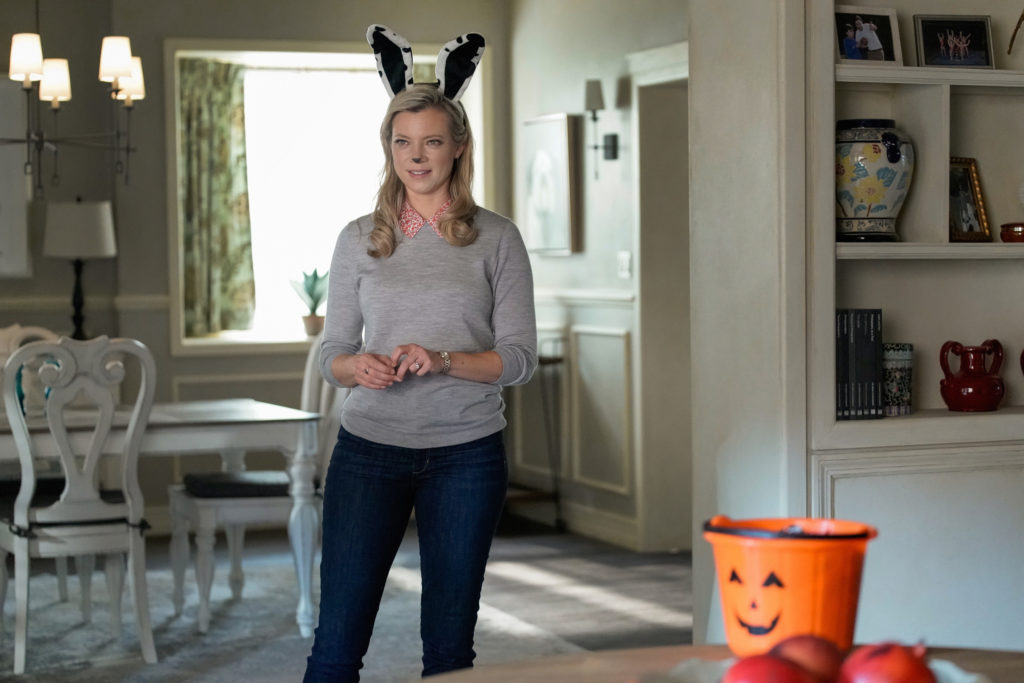 Amy Smart as Barbara Whitmore dressed in Halloween themed bunny ears.