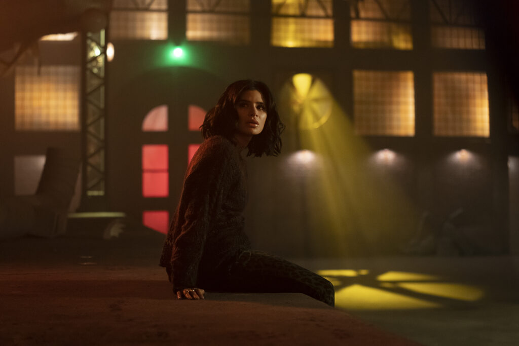 Diane Guerrero as Jane, sitting on a bed in the Underground.