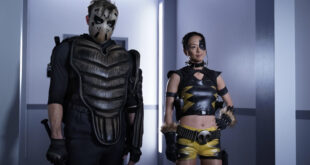 Left to Right: Neil Hopkins as Sportsmaster and Joy Osmanski as Tigress