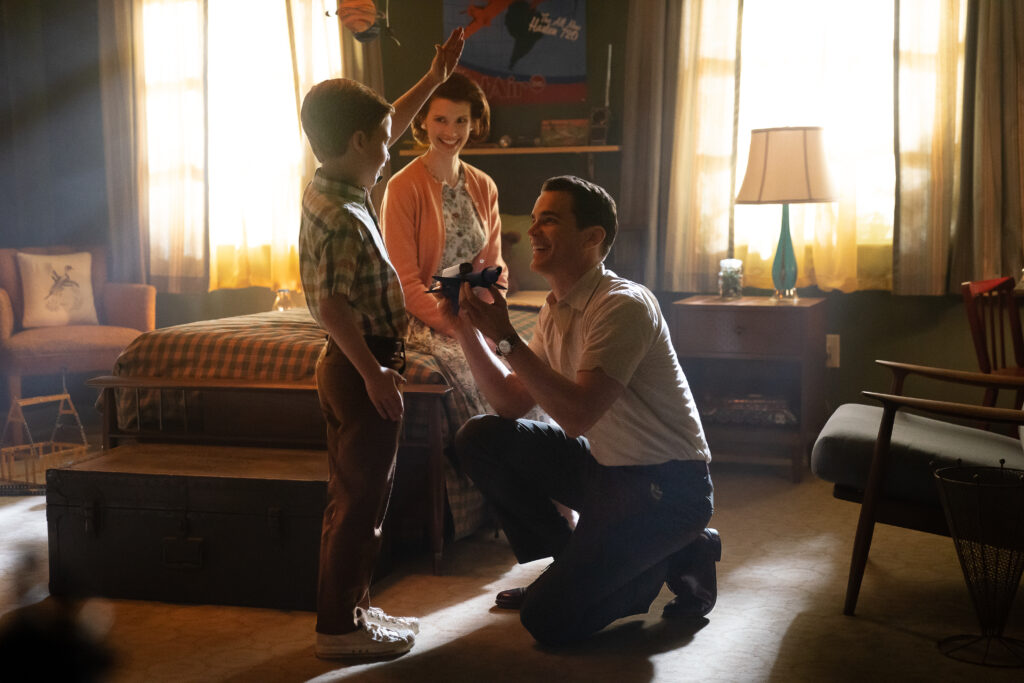 Matt Bomer as Larry Trainor talking to his son, Gary, in front of his wife.