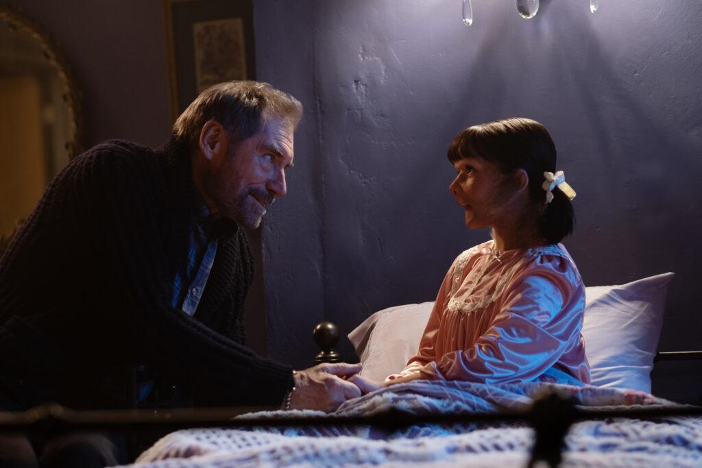 Timothy Dalton as Niles Caulder and Abigail Shapiro as Dorothy