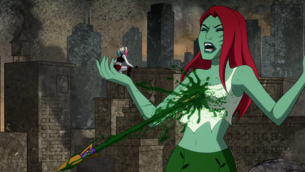 A scene from season 1 where a giant Poison Ivy is holding Harley Quinn while being shot by Joker acid.