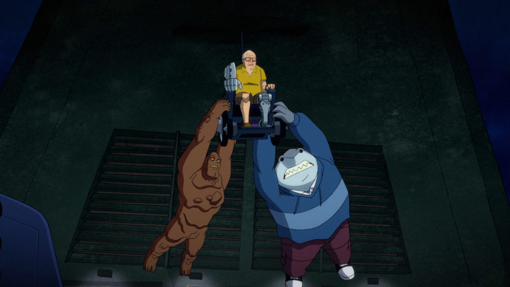 Sy Borgman is flying in his chair, carrying Clayface and King Shark.