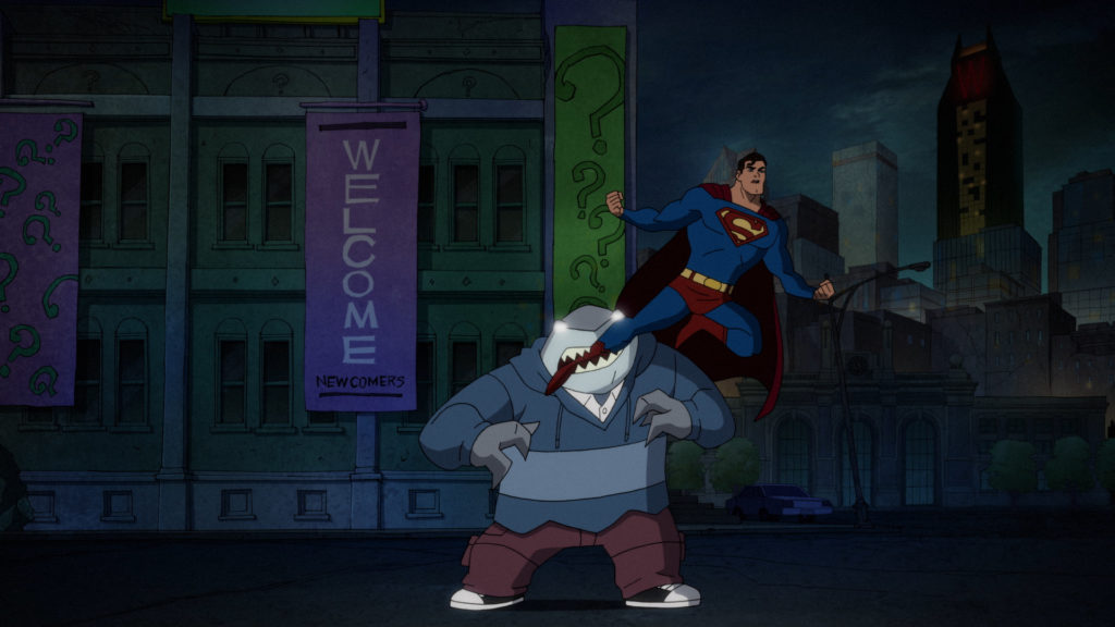 Mind-controlled King Shark bites the leg of Superman.