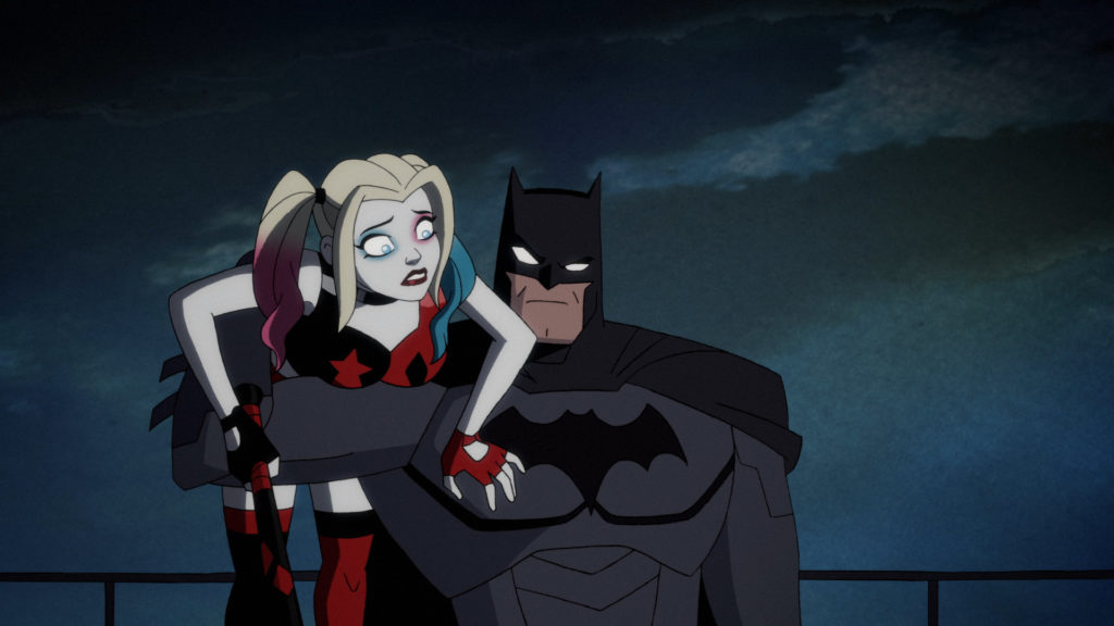 A recently-rescued Harley Quinn is being held under one arm by Batman.