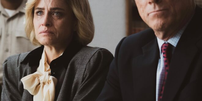 Amanda Peet as Betty Broderick next to her lawyer, awaiting a verdict.