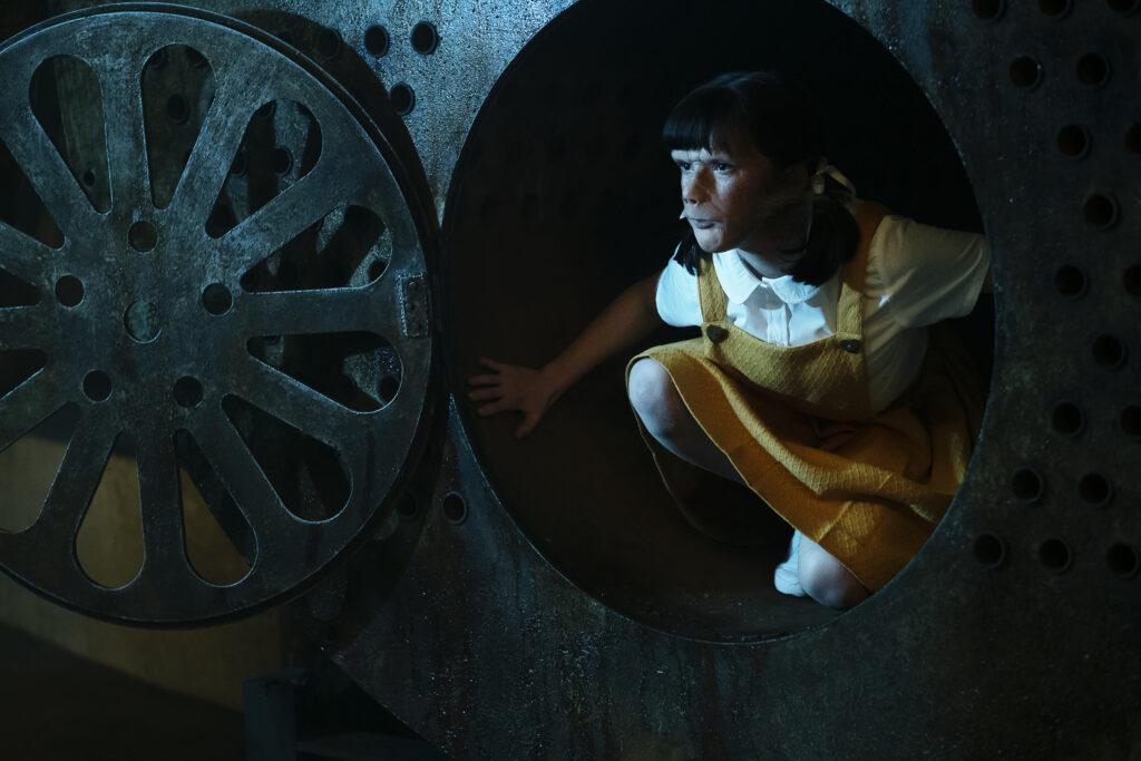 Abigail Shapiro as Dorothy Spinner, hiding.