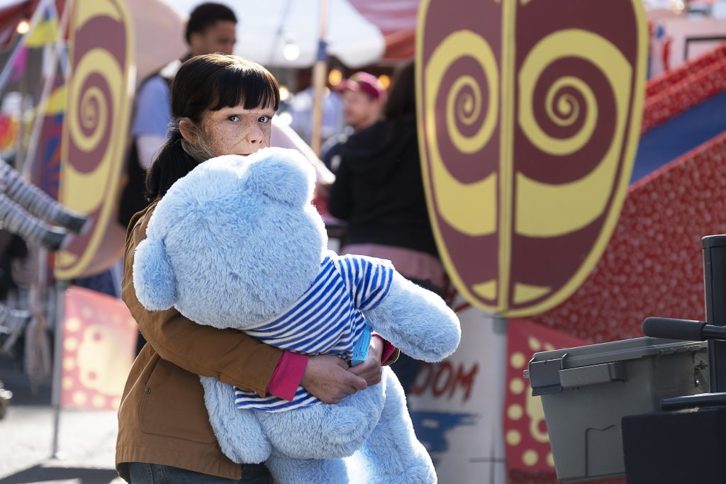 Dorothy holding a giant teddy bear at the fair.