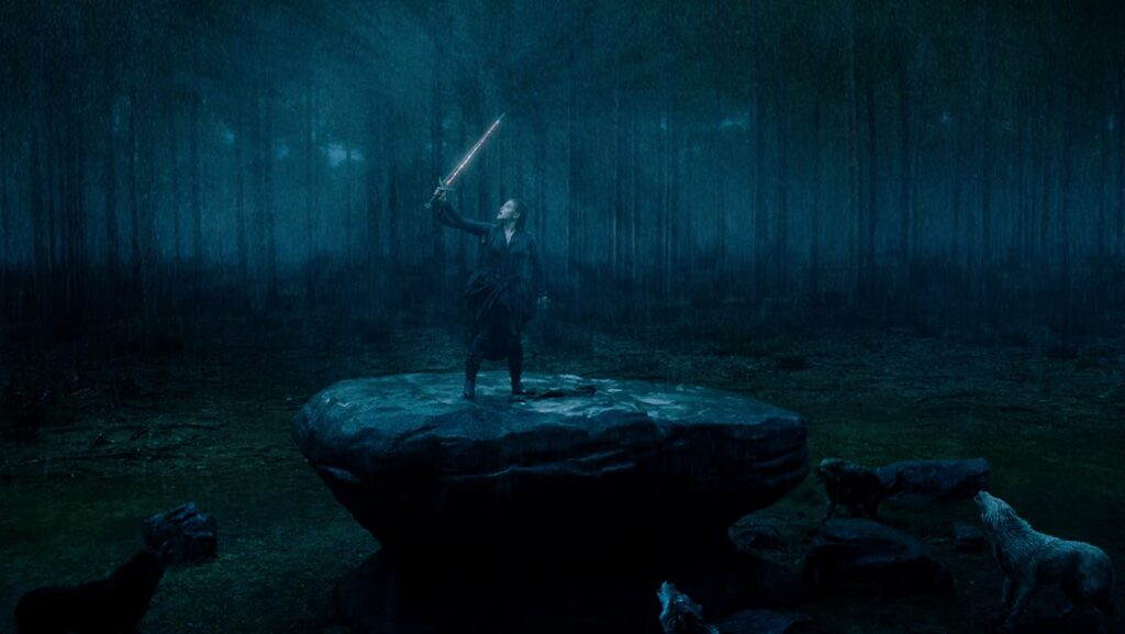 Nimue wields the blade meant to become Excalibur.