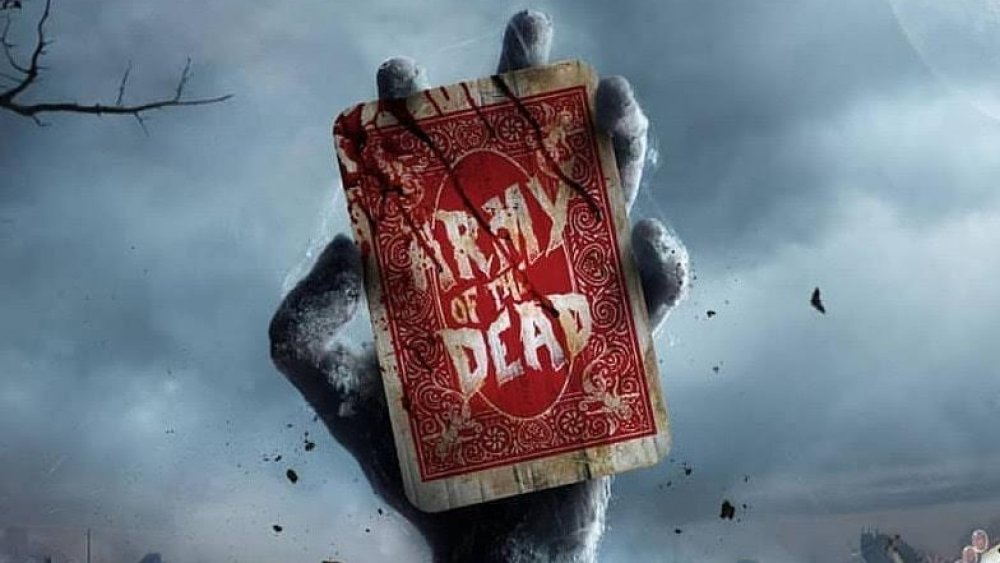 "A zombie hand holds a bloody playing card with the words ""Army of the Dead"" written on the back."