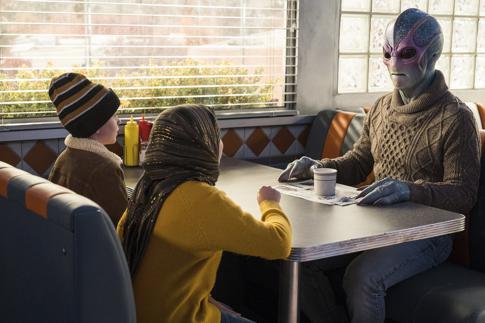 Max and Sahar speak with Harry in Resident Alien Episode 5